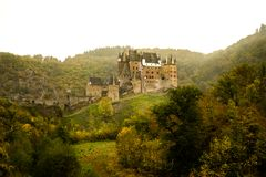 Burg Eltz in the mist stock photography