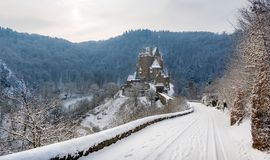 Burg Eltz at winter. Snowy winter road to fairy tale castle Burg Eltz. Germany Stock Photo