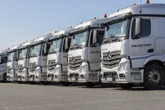 German Mercedes Benz Actros trucks from haulage firm Neumann. BURG / GERMANY - JUNE 11, 2017: german Mercedes Benz Actros trucks from haulage firm Neumann stands stock photography