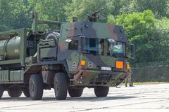 German military MAN Multi 2 swap body truck tanker. BURG / GERMANY - JUNE 25, 2016: german military MAN Multi 2 swap body truck tanker at open day in barrack stock photo