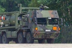 German military MAN Multi 2 swap body truck tanker. BURG / GERMANY - JUNE 25, 2016: german military MAN Multi 2 swap body truck tanker at open day in barrack royalty free stock images