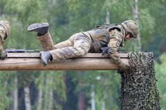 German soldier with hk g 36 rifle on assault course. BURG / GERMANY - JUNE 25, 2016: german soldier with hk g 36 rifle on assault course , at open day in barrack Stock Images