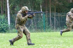 German soldier with hk g 36 rifle on assault course. BURG / GERMANY - JUNE 25, 2016: german soldier with hk g 36 rifle on assault course , at open day in barrack Royalty Free Stock Photos