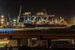 Burgas, Bulgaria - August 26, 2015    21:29h : Cargo cranes on the coast of Fish port of Burgas, Bulgaria Royalty Free Stock Photography