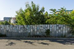 One of the many walls of commemoration. BURGAS, BULGARIA - AUGUST 20, 2017: One of the many walls of commemoration. Unusual Bulgarian tradition Vspomen to Royalty Free Stock Photography