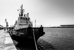 Tugboat near the pier in the seaport of Bourgas. Royalty Free Stock Image