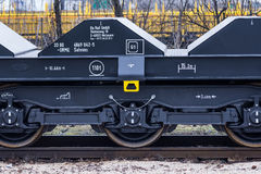 Burgas, Bulgaria - January 24, 2017 - Freight cargo train - black cars wagons - New 6-axled flat wagon - Type: Sahmmn - Model WW 6 royalty free stock image