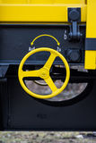 Burgas, Bulgaria - January 27, 2017 - Handbrake - yellow black New 4-axled flat cars wagons Type:Res Model:072-2- Transvagon AD Stock Photo