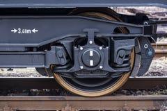 Burgas, Bulgaria - January 24, 2017 - Wheel - Freight cargo train - black cars wagons - New 6-axled flat wagon - Type: Sahmmn - Mo Royalty Free Stock Images
