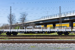 Burgas, Bulgaria - March 20, 2017 - Freight cargo train - 4axled flat wagon white Type:Rens Model:192, B - Transvagon AD. Burgas, Bulgaria - March 20, 2017 Royalty Free Stock Photography