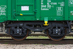 Burgas, Bulgaria - March 20, 2017 - Freight cargo train Wheels- 4axled box wagon green Type:Eanos Model:155-1 - Transvagon AD Stock Photos