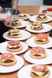 Burger μαγείρεμα Στοκ Φωτογραφία