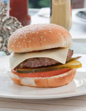Burger. Barbecue on a back yard. Fresh home made cheeseburger Royalty Free Stock Photography