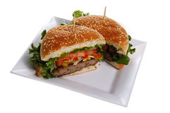 Burger. Beef burger with vegetables served on white plate stock photo