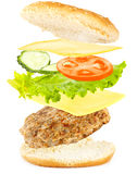 Burger. Ingredients for a burger fall on a roll stock photography