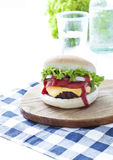 Burger. Homemade Burger on wooden board royalty free stock photo