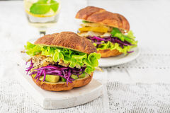 Burger with avocado, white meat grilled chicken Royalty Free Stock Photos