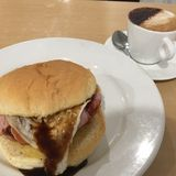Burger. Bacon and eggs burger with coffee for breakfast Royalty Free Stock Photo