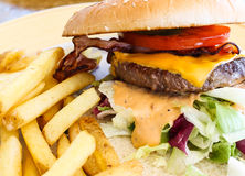 Burger with bacon and fries Stock Photo