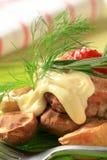 Burger and baked potatoes Royalty Free Stock Photos