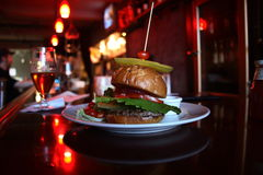 Burger in a bar Royalty Free Stock Photos