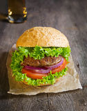 Burger with beef cutlet, lettuce, onions and tomato Royalty Free Stock Image