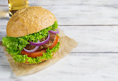 Burger with beef cutlet, lettuce, onions and tomato Stock Photography