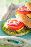 Burger with beef patty cheese lettuce onion tomato Royalty Free Stock Photography