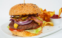 Burger with beef patty tomato onion and potato chips Stock Images