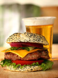 Burger and beer royalty free stock photos