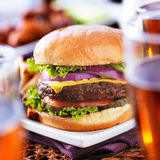 Burger with beer glasses and chicken wings royalty free stock photography