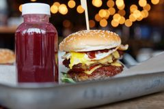 Burger and berry smoothie on metal tray Royalty Free Stock Photo
