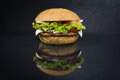 Burger on black background royalty free stock photos