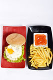 Burger with black pepper and French fries Royalty Free Stock Photo