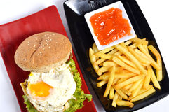 Burger with black pepper and French fries Stock Photography