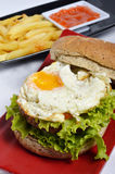 Burger with black pepper and French fries Stock Images