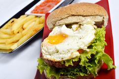 Burger with black pepper and French fries Stock Photos