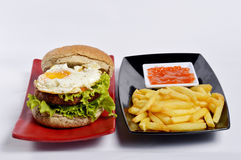 Burger with black pepper and French fries Royalty Free Stock Photos