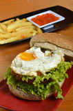 Burger with black pepper and French fries Royalty Free Stock Image