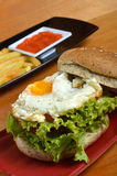 Burger with black pepper and French fries Stock Image