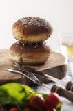 Burger bread buns on a table set Royalty Free Stock Photos