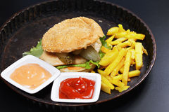Burger with breast cutlet Stock Photos
