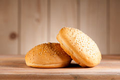 Burger buns. On a rustic background stock images