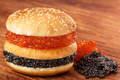 Burger with caviar Royalty Free Stock Photography