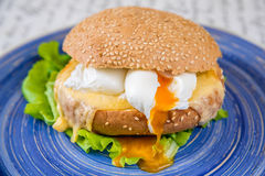Burger with cheese, egg and salad Stock Image