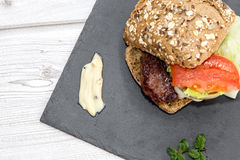 Burger with cheese, tomato, lettuce a Royalty Free Stock Images