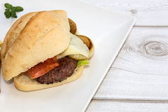 Burger with cheese, tomato, lettuce Stock Image