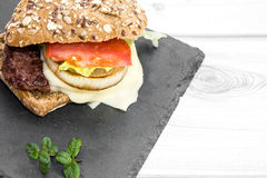 Burger with cheese, tomato, lettuce and chips Stock Photography