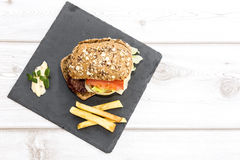 Burger with cheese, tomato, lettuce and chips Stock Photos