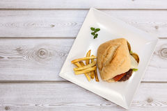 Burger with cheese, tomato, lettuce and chips Stock Photo